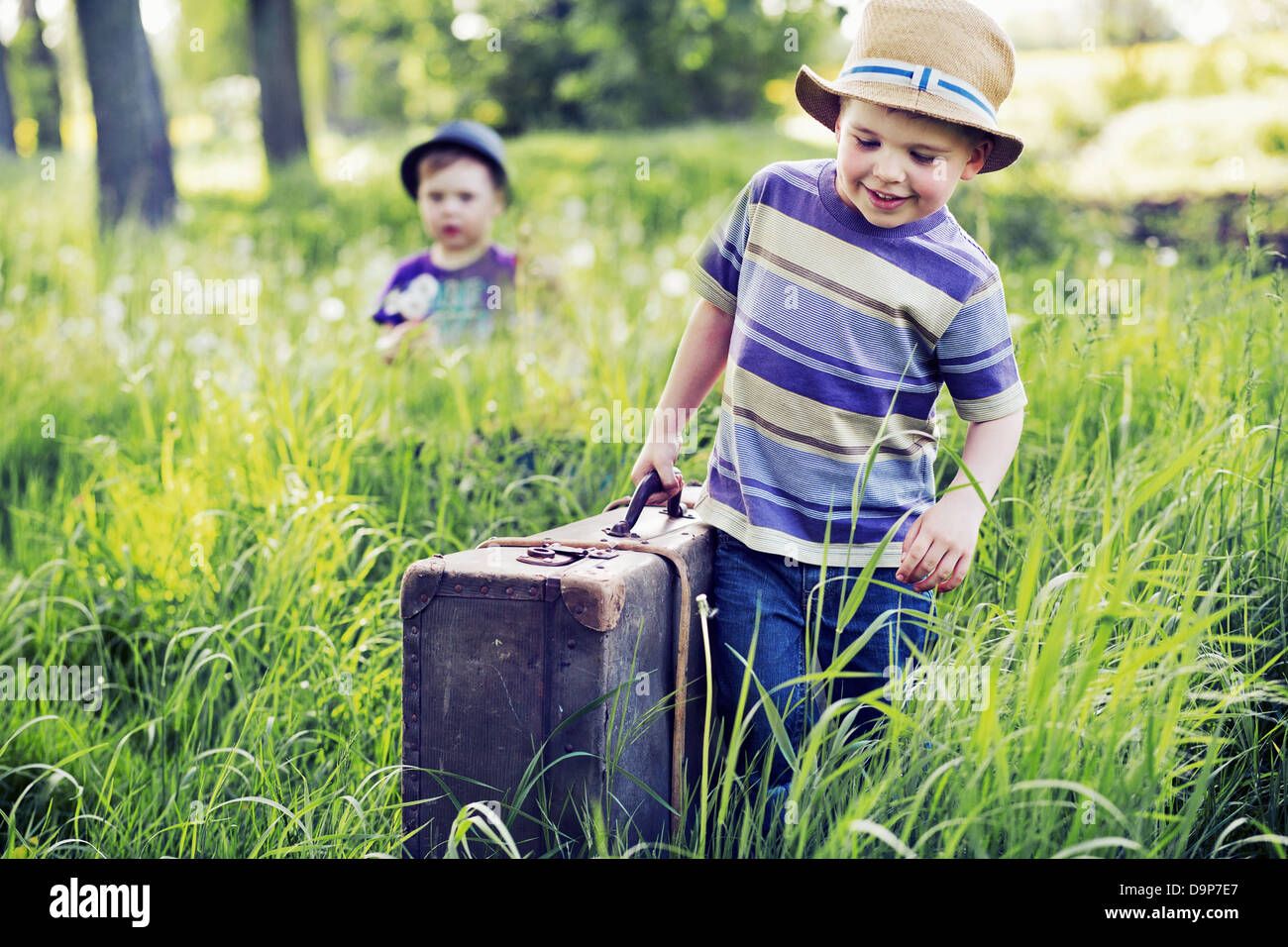 Two cute brothers starting the journey - Stock Image