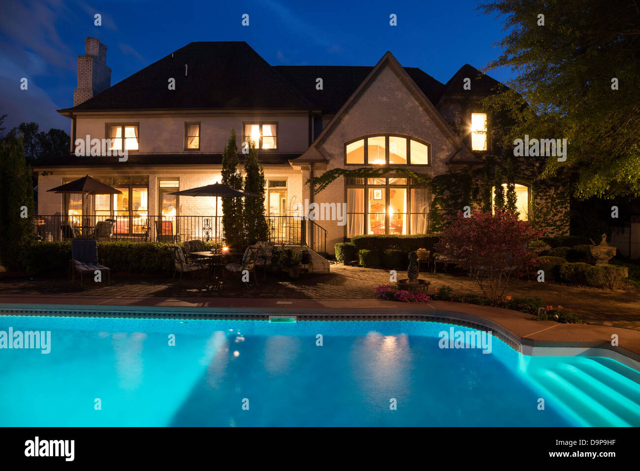 Luxury Home With Swimming Pool At Night Usa Stock Photo Alamy