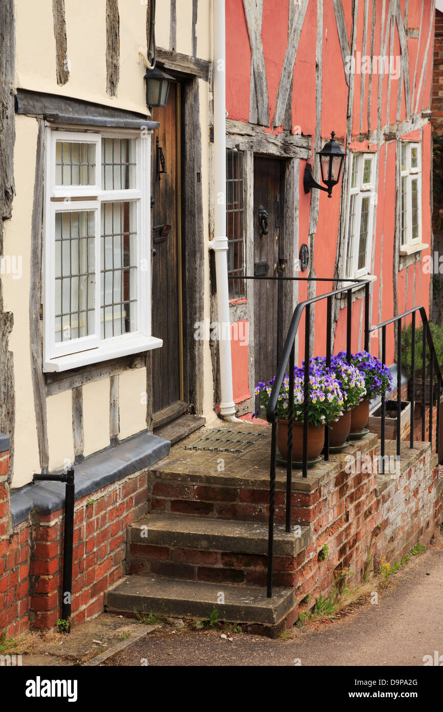 Steps leading up from a street to front door of a timbered house in medieval village of Lavenham, Suffolk, England, - Stock Image