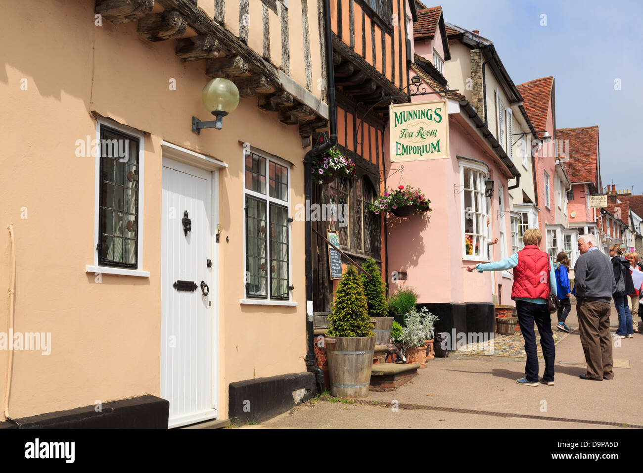 People outside Munnings Tea Room Emporium in the historic village centre. High Street, Lavenham, Suffolk, England, - Stock Image
