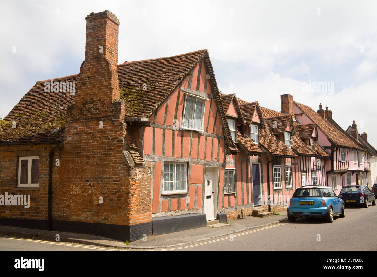 Lavenham Suffolk East Anglia England Pastel coloured half timbered houses in  medieval village one of 20th wealthiest Stock Photo