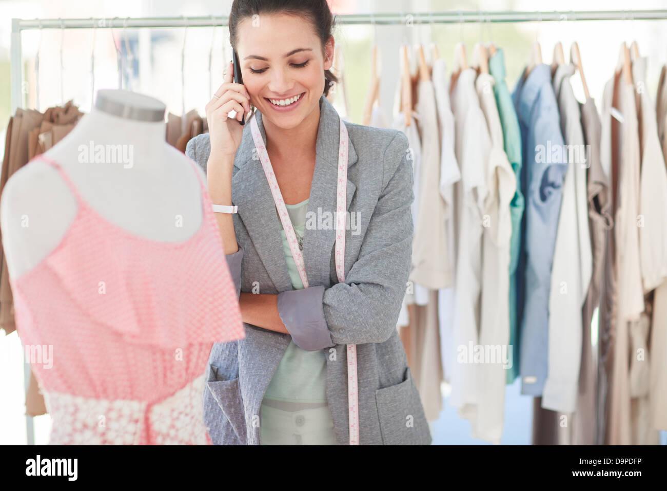 Fashion designer on the phone - Stock Image