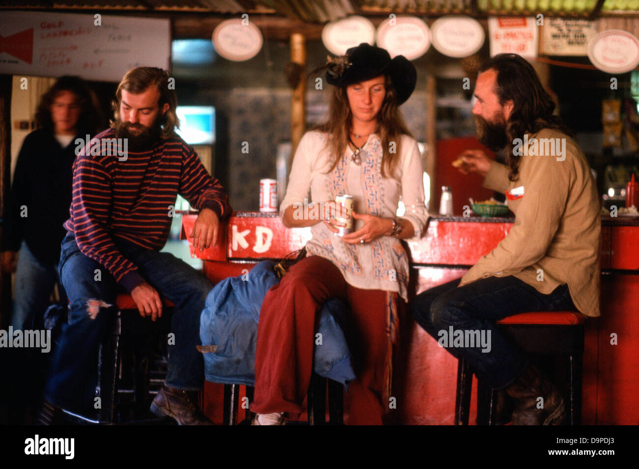 Hippies  having a drink inside a bar in Mendocino,Northern California, USA 1977  KATHY DEWITT - Stock Image
