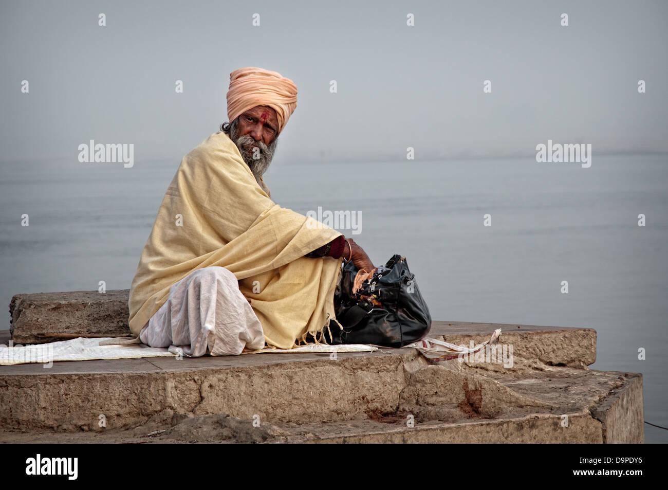 Sadhu on the gaths. Varanasi, Benares, Uttar Pradesh, India - Stock Image