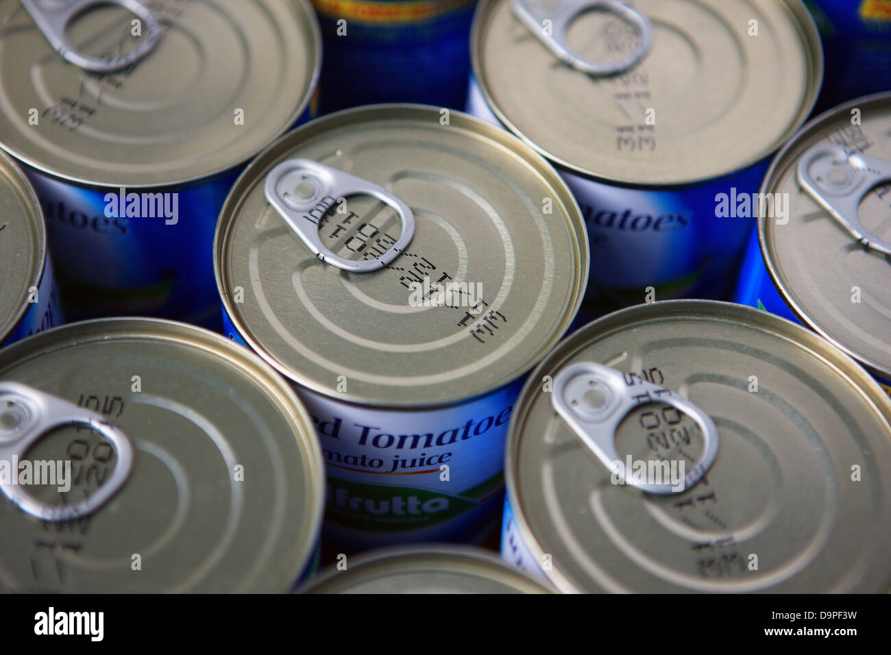 ring pull lids on tins of tomatoes - Stock Image