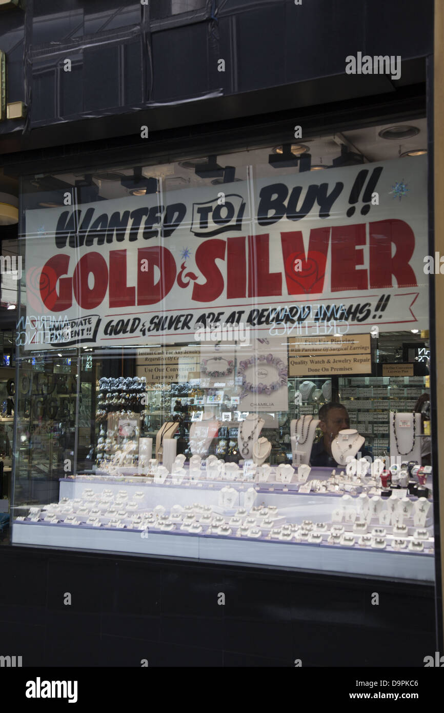 Gold and silver are in demand during uncertain economic times. Jewelers & precious metal buyers in the financial - Stock Image