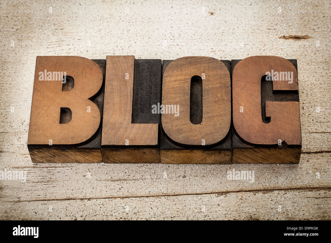 blog - a word in vintage letterpress wood type on a grunge painted barn wood background - Stock Image