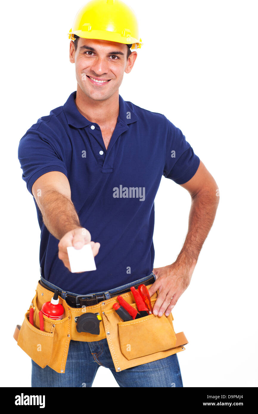 handsome handyman handing over his business card over white background - Stock Image
