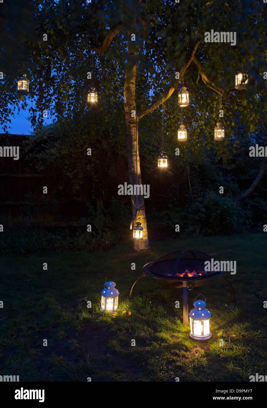 lanterns in garden tree - Stock Image
