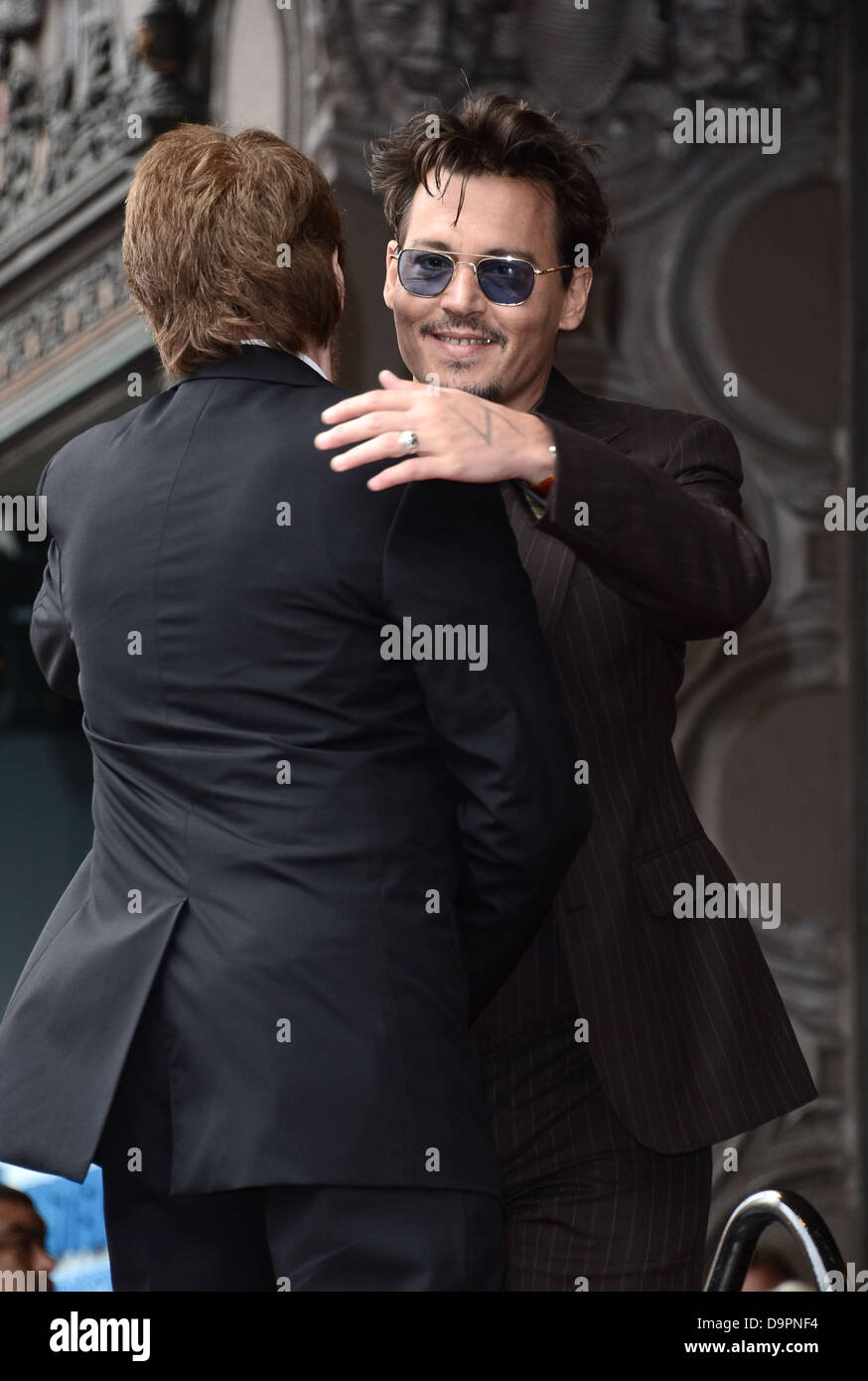 Los Angeles, USA. 24th June, 2013. Johnny Depp with producer Jerry Bruckheimer who was honoured with a star on the Stock Photo