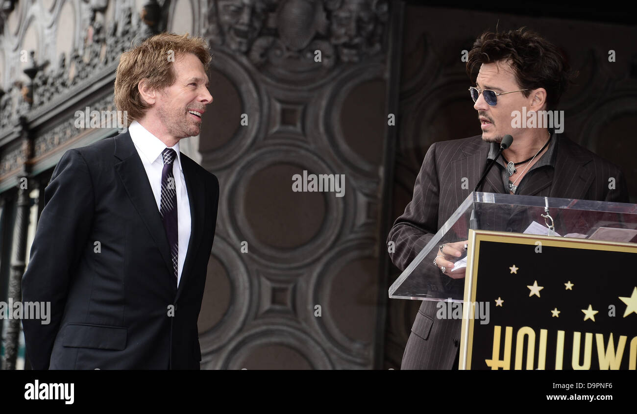 Los Angeles, USA. 24th June, 2013. Johnny Depp with producer Jerry Bruckheimer who was honoured with a star on the - Stock Image