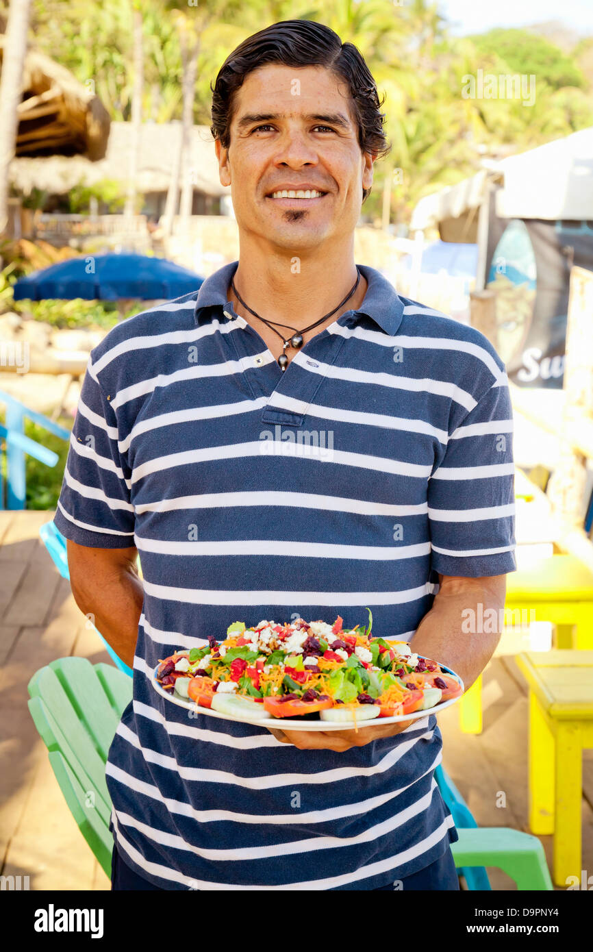 Man holding platter of mexican food Stock Photo