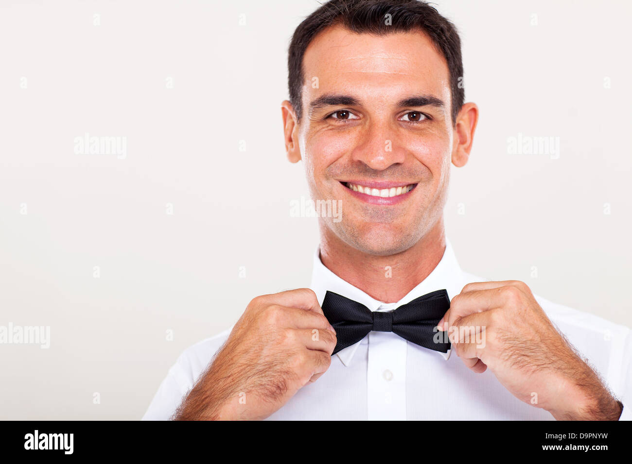 handsome waiter holding bow tie closeup Stock Photo