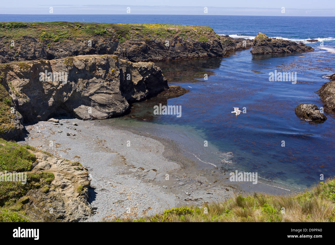 Pacific Ocean cove lagoon rocky beach sea cliff  water sandy beach Summer of 42 film location cooling beauty tranquil - Stock Image