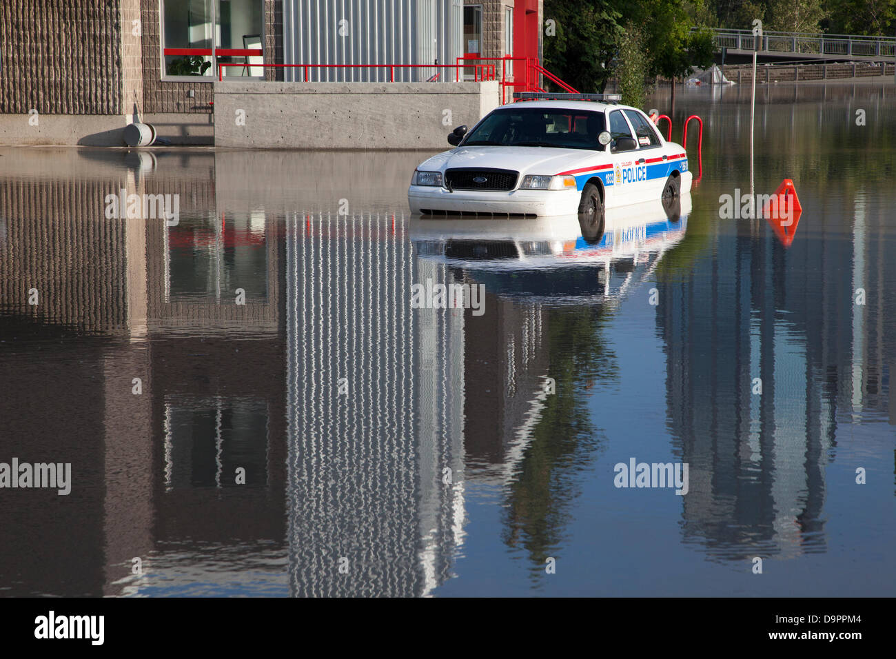 Saturday, June 22, 2013. A police car trapped in a parking lot by rapidly rising floodwaters in the Sunnyside neighbourhood Stock Photo