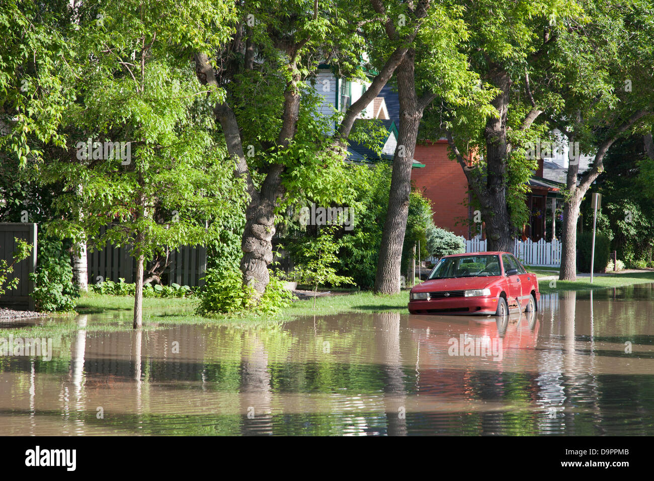 Saturday, June 22, 2013. A car trapped by floodwaters in the Sunnyside neighbourhood of Calgary, Alberta, Canada. Stock Photo
