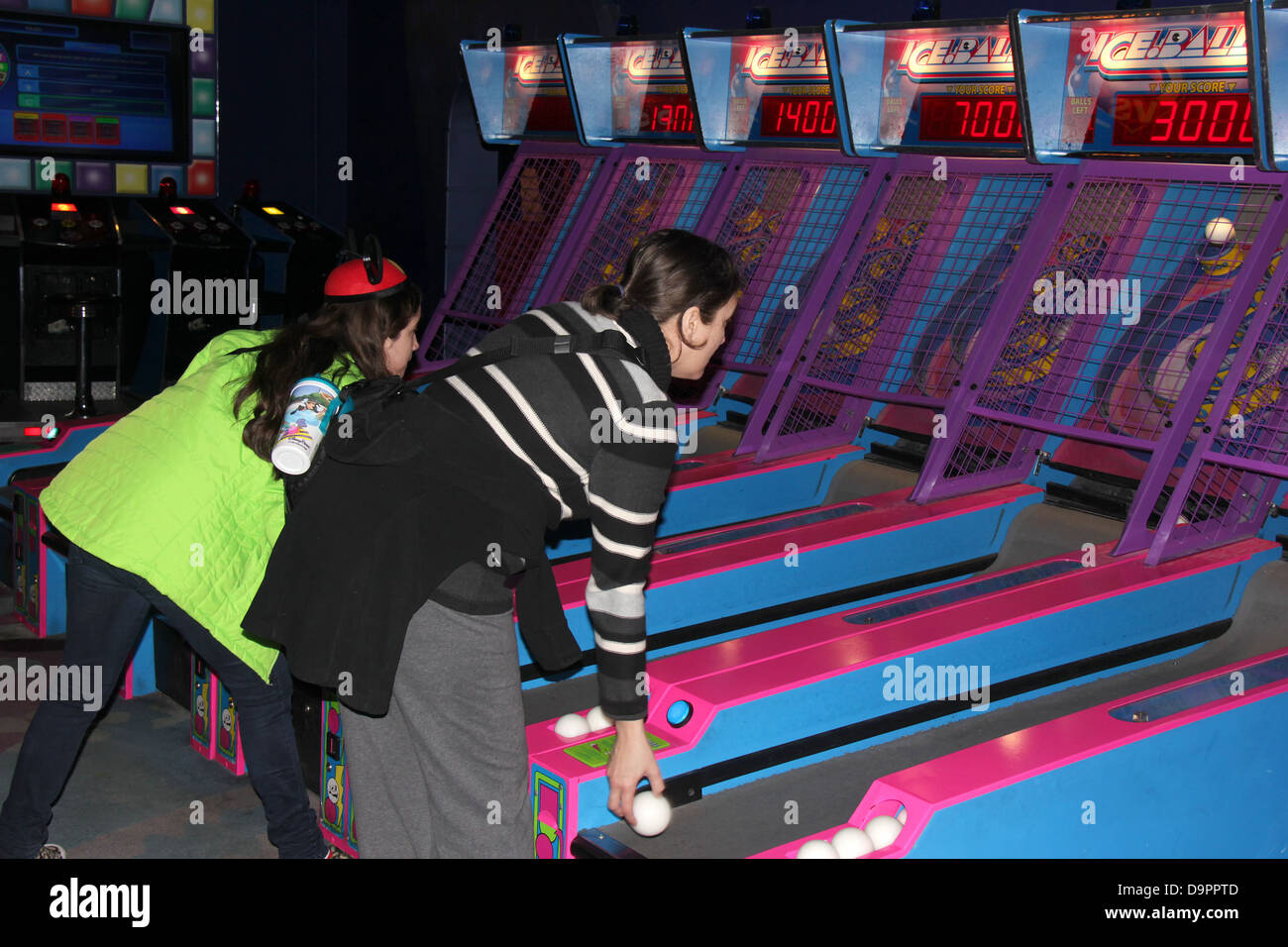 Woman and teen playing inside Disney Quest, Downtown Disney, Florida. - Stock Image