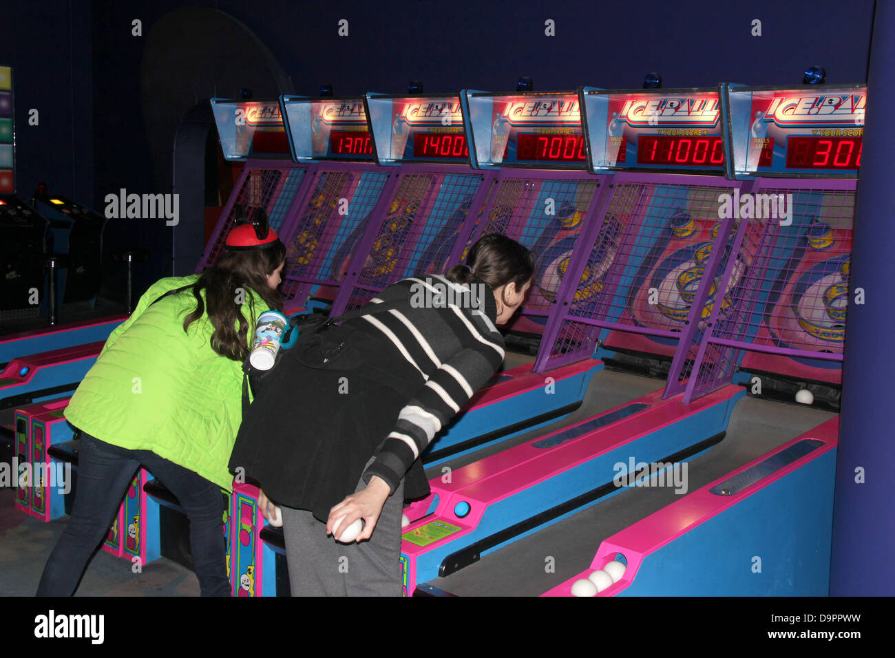 Woman and teen playing at Disney Quest, Downtown Disney. - Stock Image