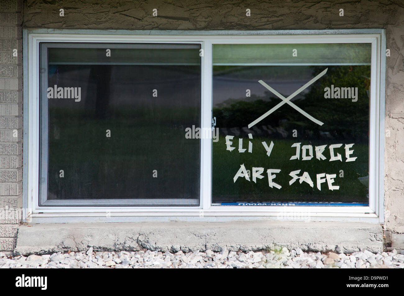 Saturday, June 22, 2013. An X on the window of this residence in Calgary, Alberta, Canada tells emergency personnel - Stock Image