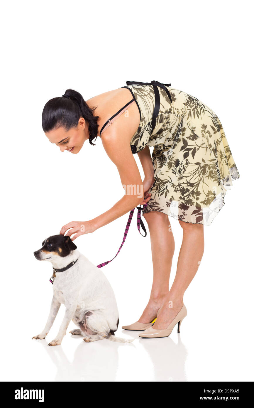 modern woman with pet dog isolated in white background - Stock Image