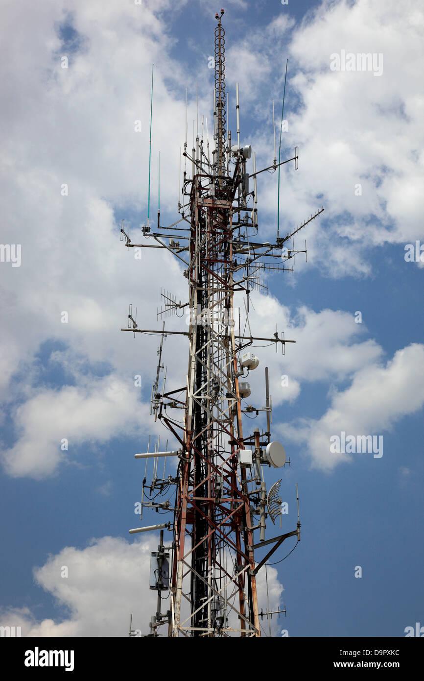 stocked with many antennas, antenna mast, here in Naples, Campania, Italy - Stock Image