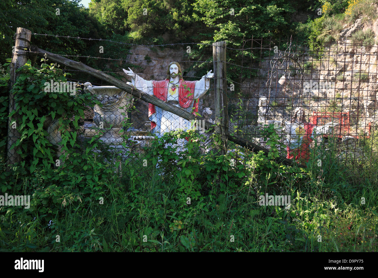 Saints on the road, behind a fence, on the peninsula of Sorrento, Campania, Italy Stock Photo