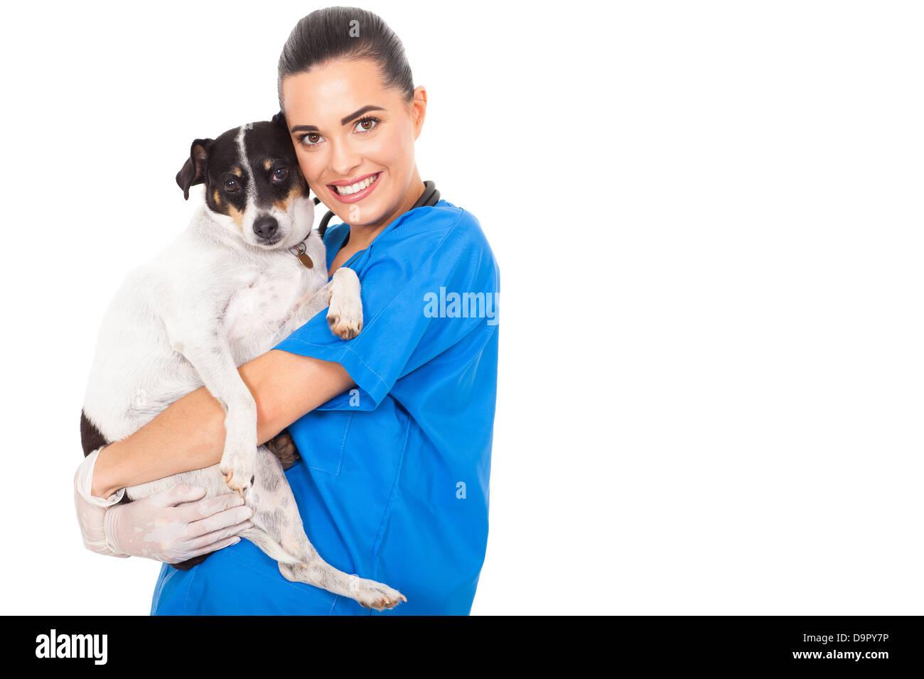 beautiful female vet doctor hugging pet dog - Stock Image