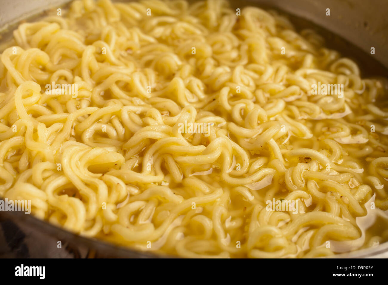 Instant Ramen cooking in a pot - Stock Image