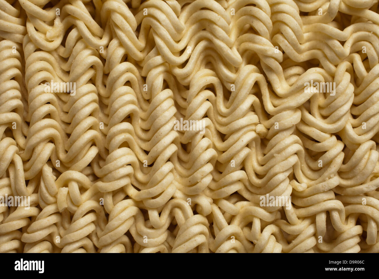 uncooked dry instant ramen noodles - Stock Image
