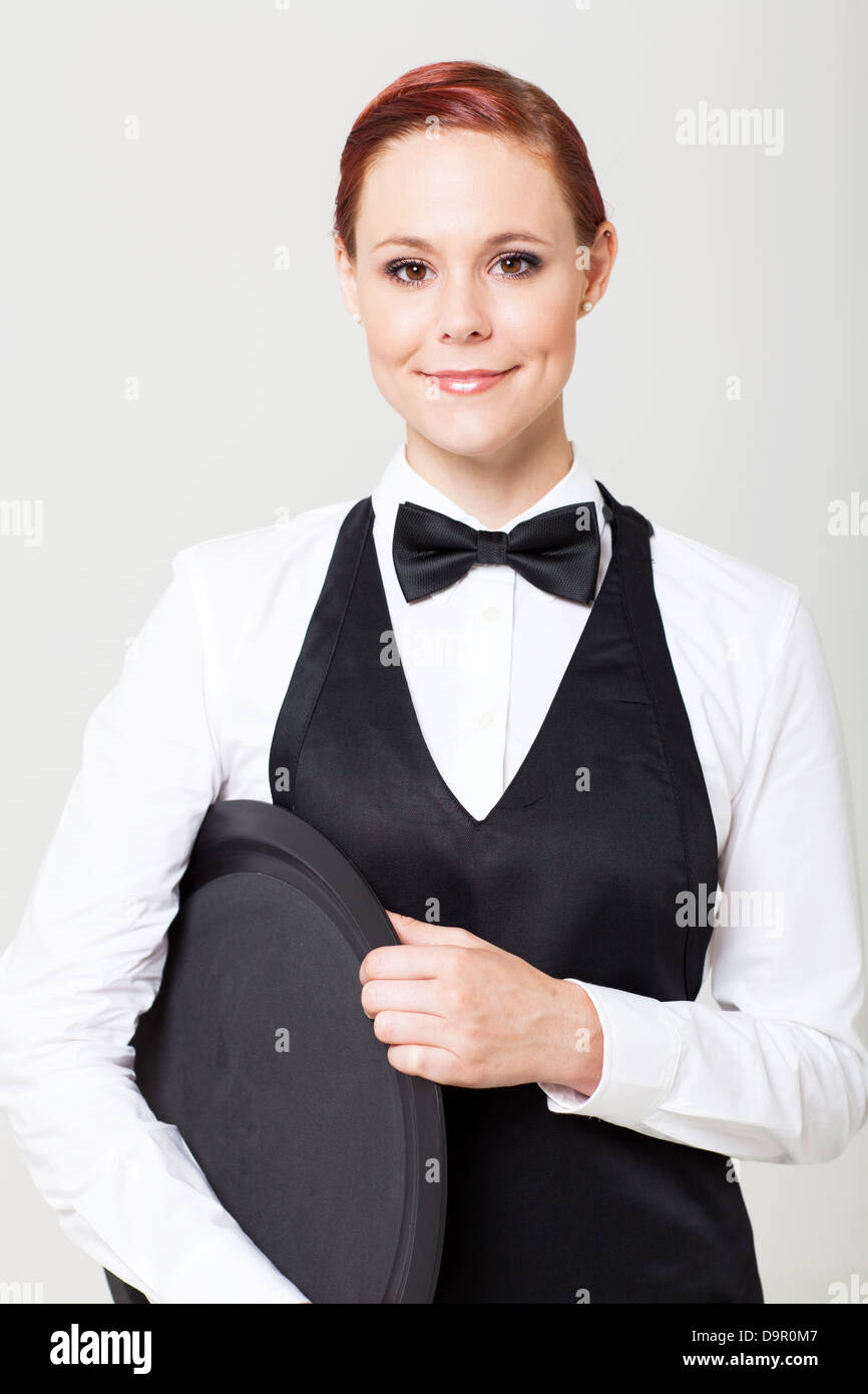 Pretty Young Waitress With Empty Tray On White Stock Photo Alamy