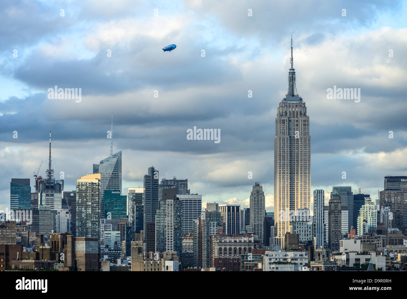 The Direct TV Blimp flying over New York City during US Open Tennis 2012 in a beautiful cloudy day - Stock Image