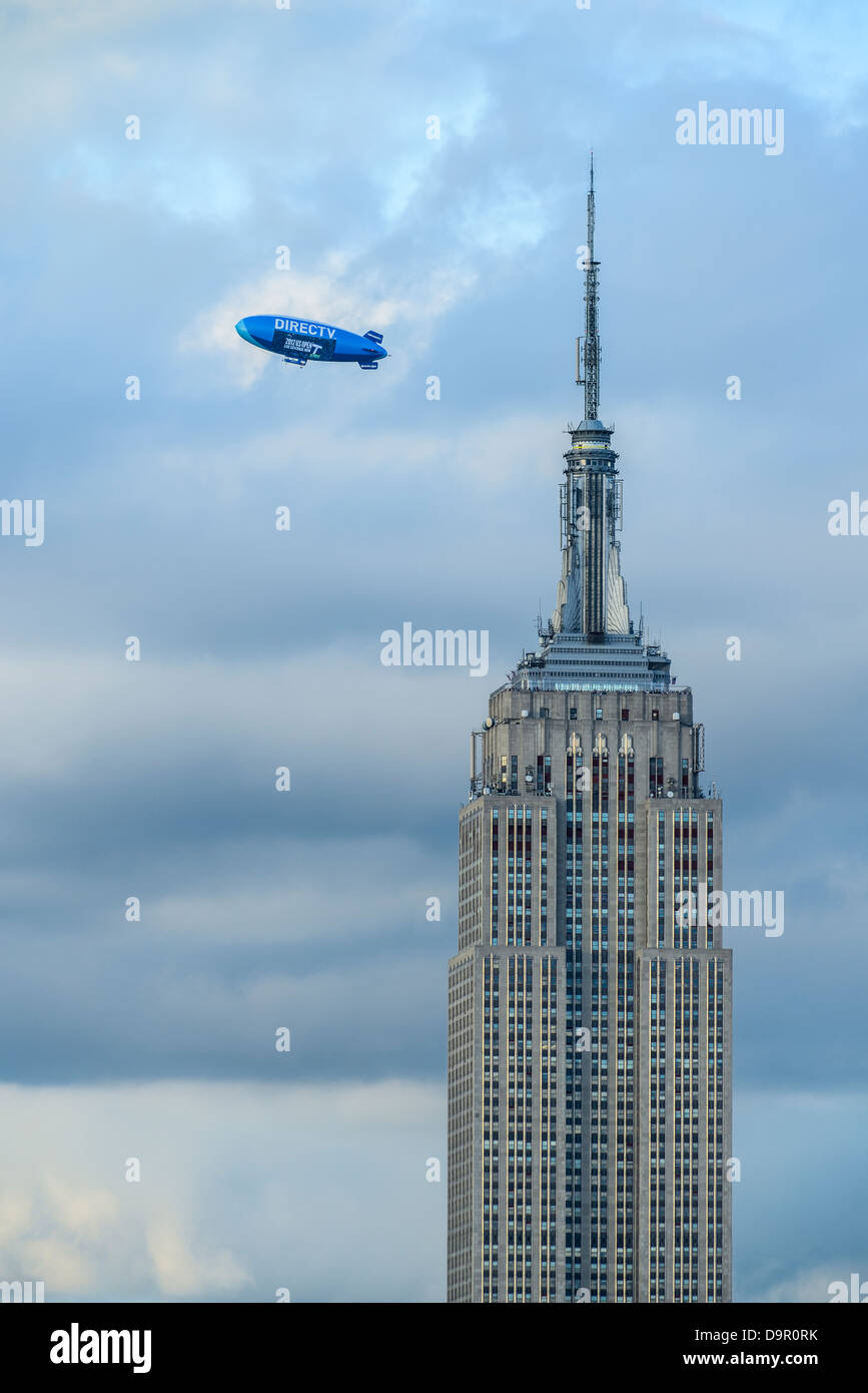 The Direct TV Blimp flying over the Empire State Building during US Open Tennis 2012 - Stock Image