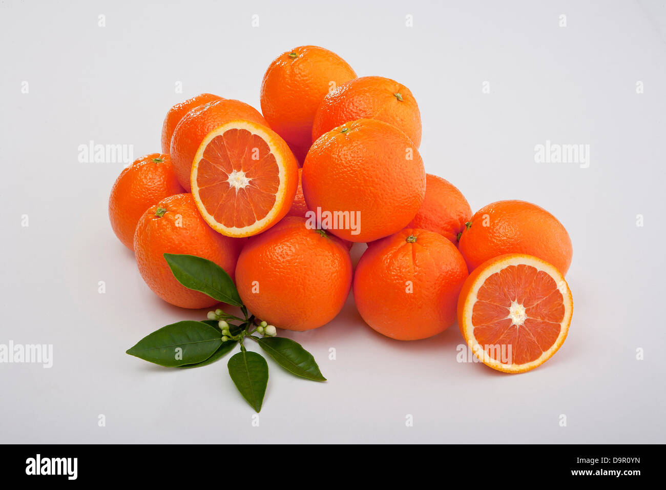 group of Mineola tangelos whole sections and cut with fresh leaves - Stock Image