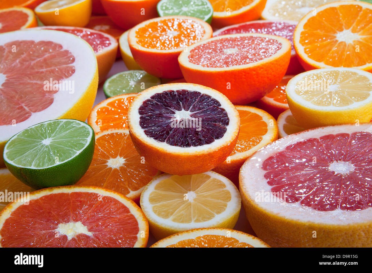 variety of cut citrus fruits - Stock Image