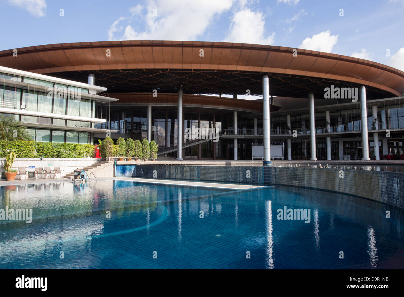 The Army Club includes a large swimming pool, exercise rooms, professional trainers, badmiten and volleyball courts. - Stock Image