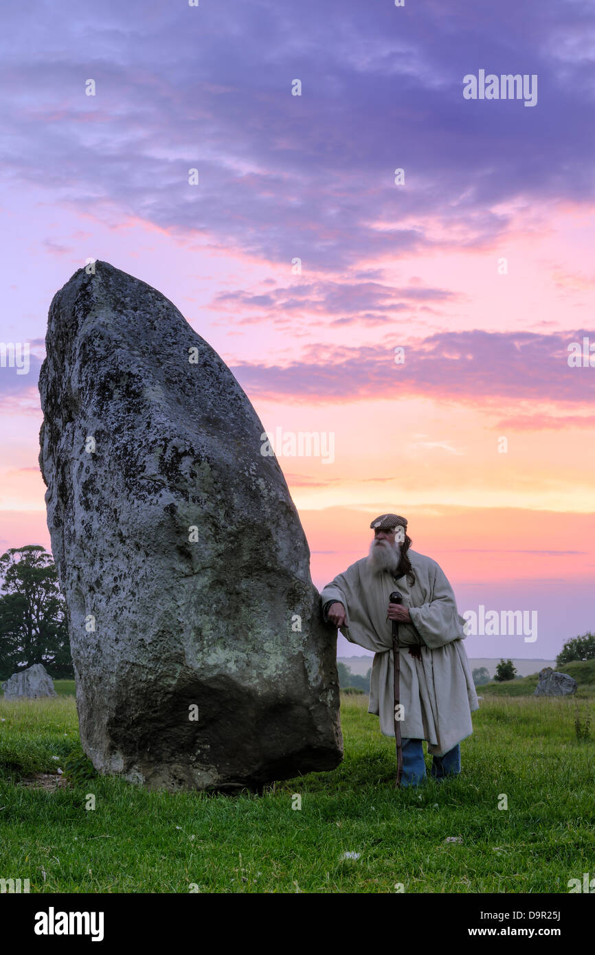 Terry, 'The Keeper of the Stones' - Leaning against the 'BrokenHeart Stone' - Avebury, Wiltshire - Stock Image