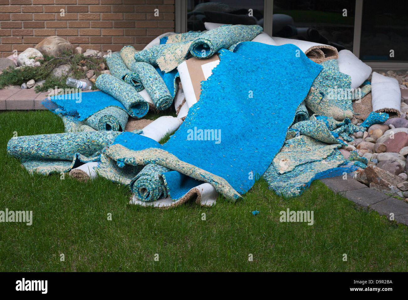 Waterlogged carpets pile up as cleanup begins after floodwaters recede from the Sunnyside neighbourhood of Calgary, - Stock Image