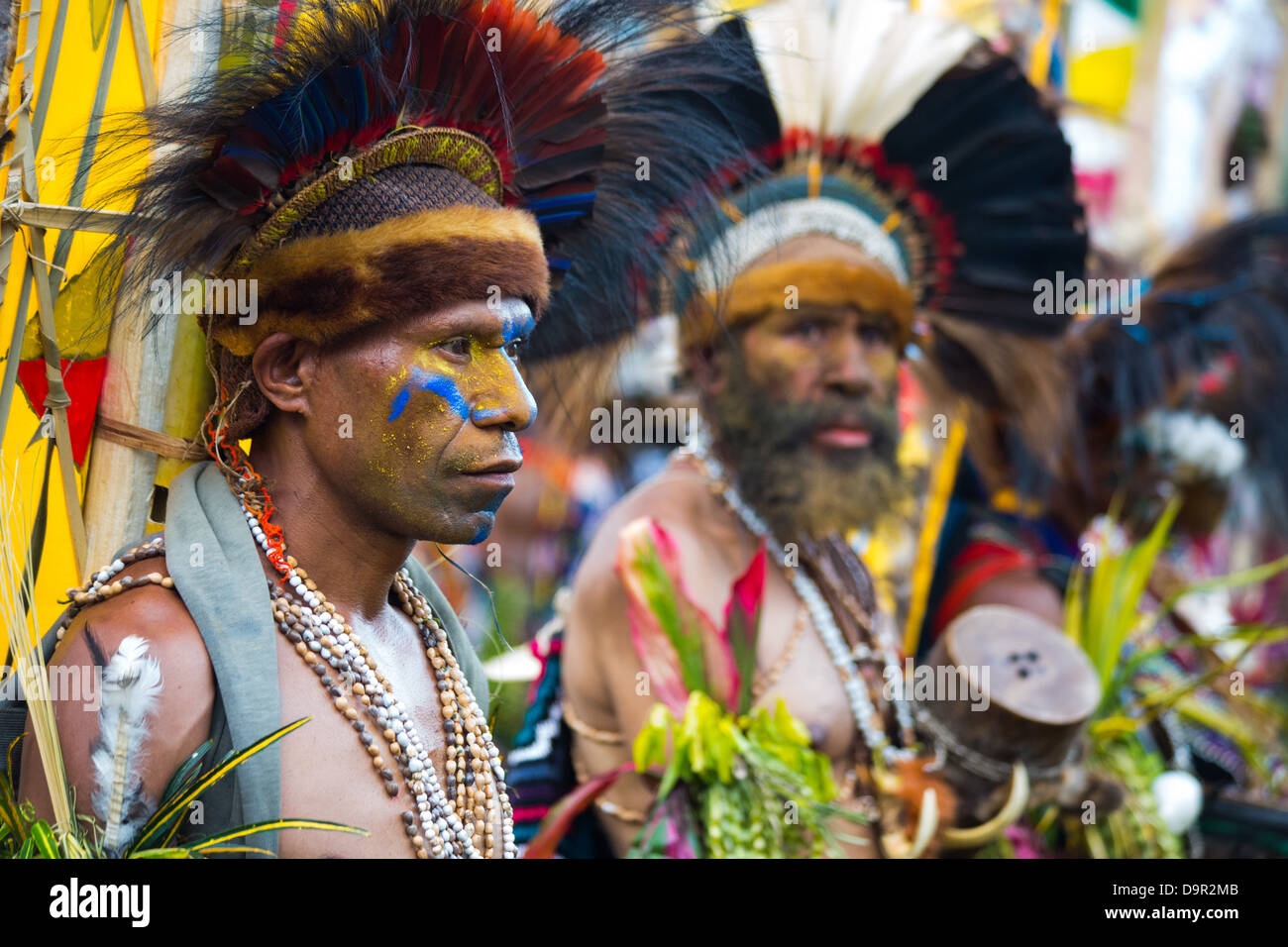 Men dressed in traditional tribal outfits and wearing feather and animal skin headresses, Goroka Show, Papua New Stock Photo