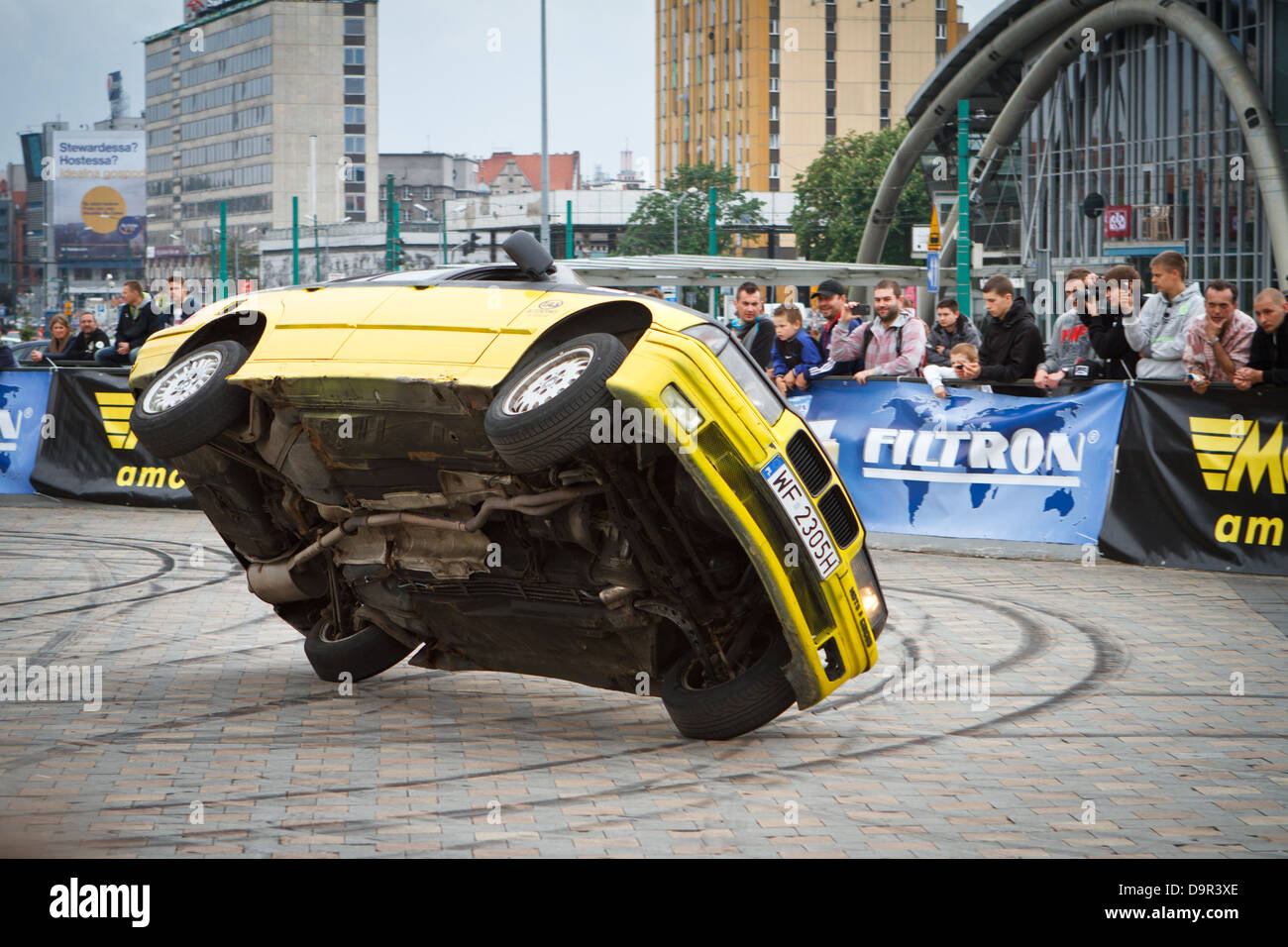 Car Stunt Show. Car driving on two wheels. Katowice, Poland. - Stock Image