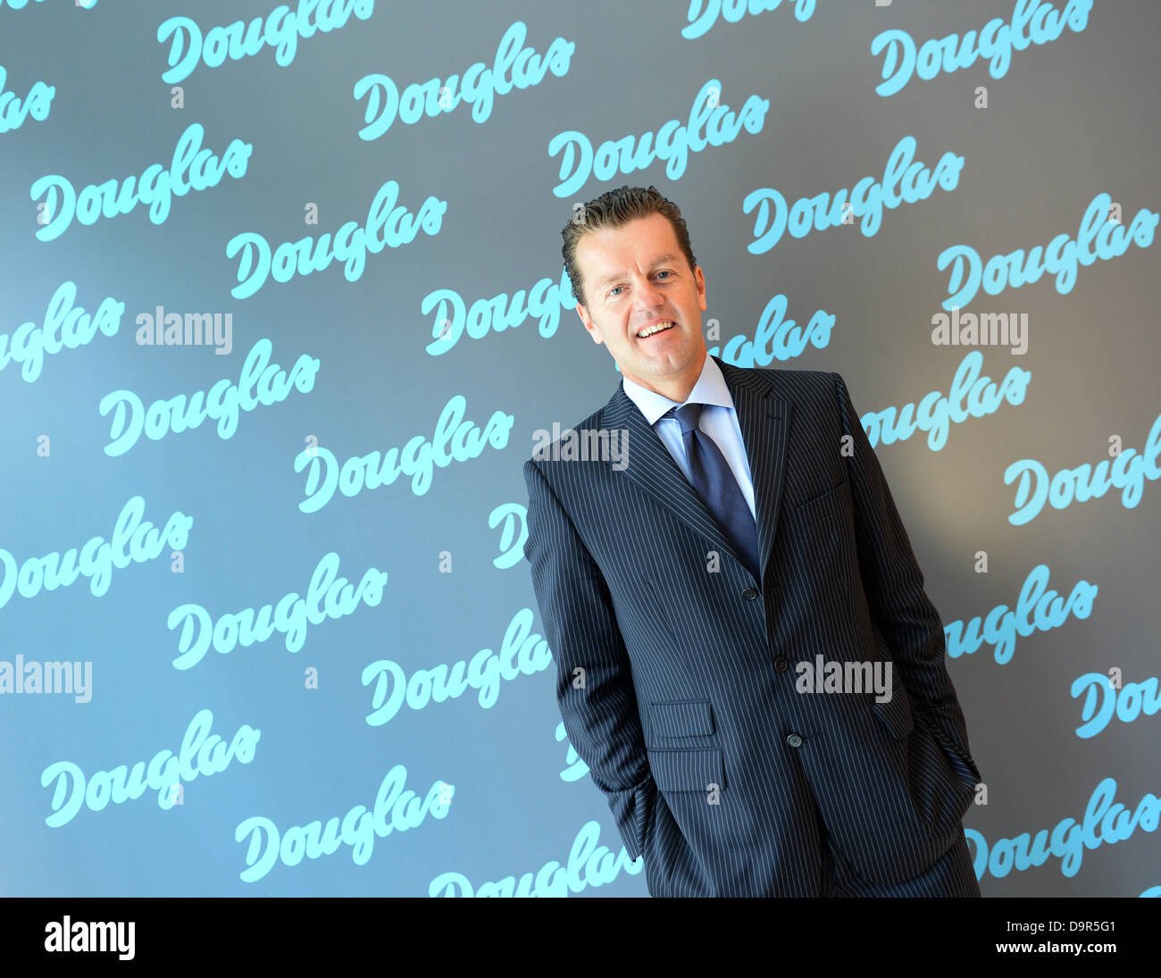 CEO of Douglas Holding AG, Henning Kreke, looks into the cameras after a press conference of the company in Frankfurt - Stock Image