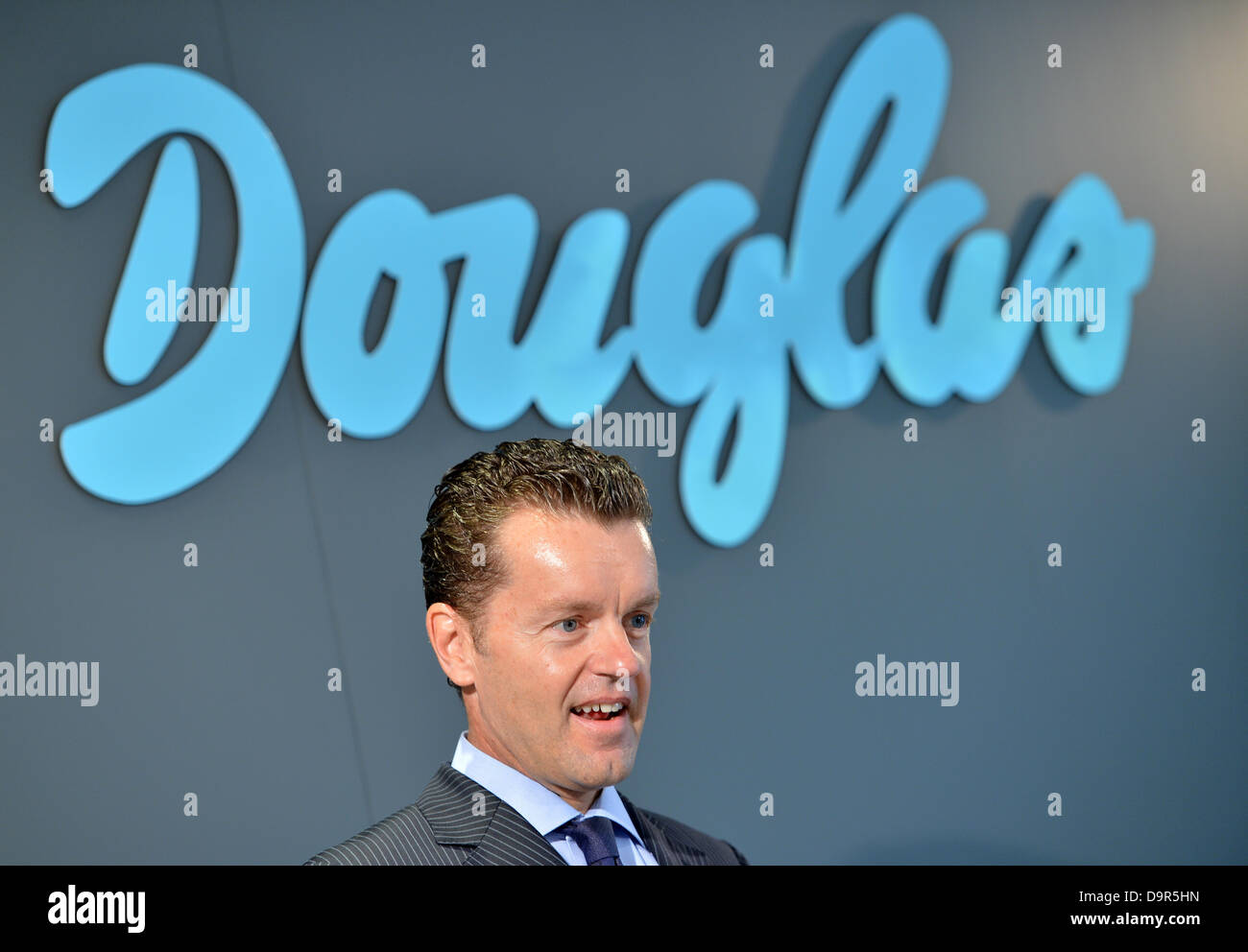 CEO of Douglas Holding AG, Henning Kreke, speaks at a press conference of the company in Frankfurt Main, Germany, - Stock Image