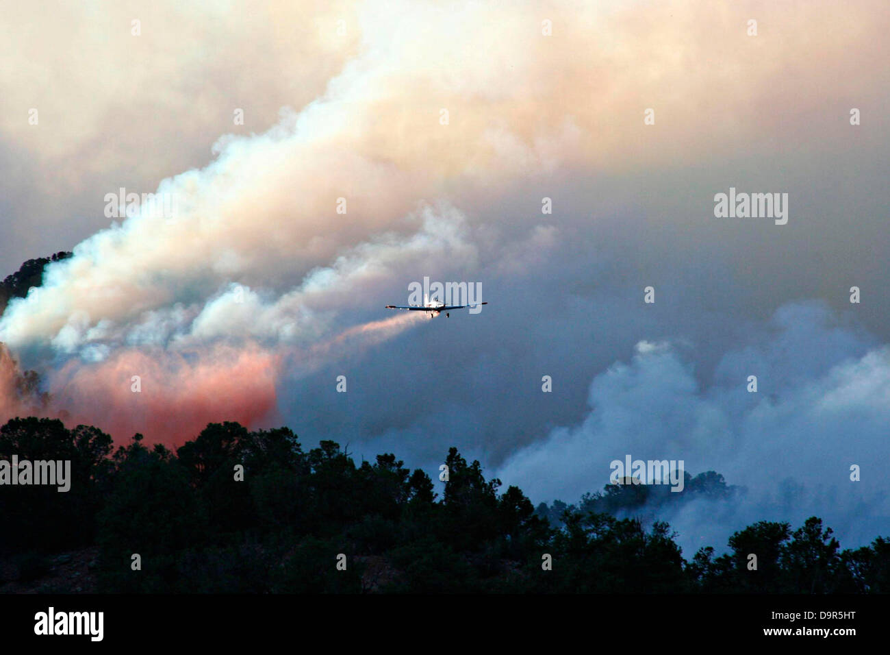 A firefighting aircraft drops suppressant on the Brush Creek Fire June 24, 2013 approximately 12 miles north of - Stock Image