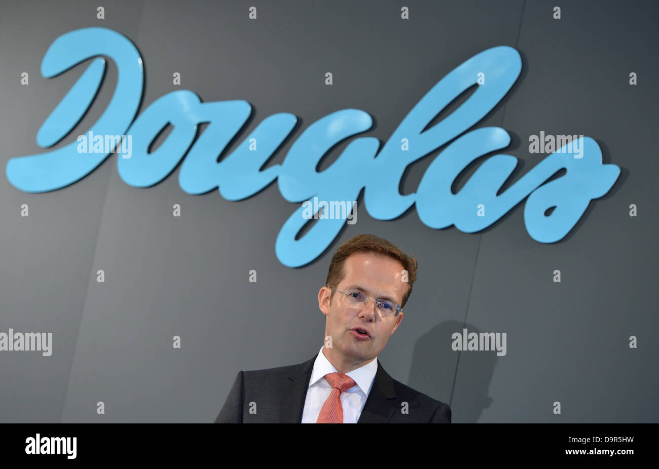 Member of the executive board of Douglas Holding AG, Manfred Kroneder, speaks at a press conference of the company - Stock Image