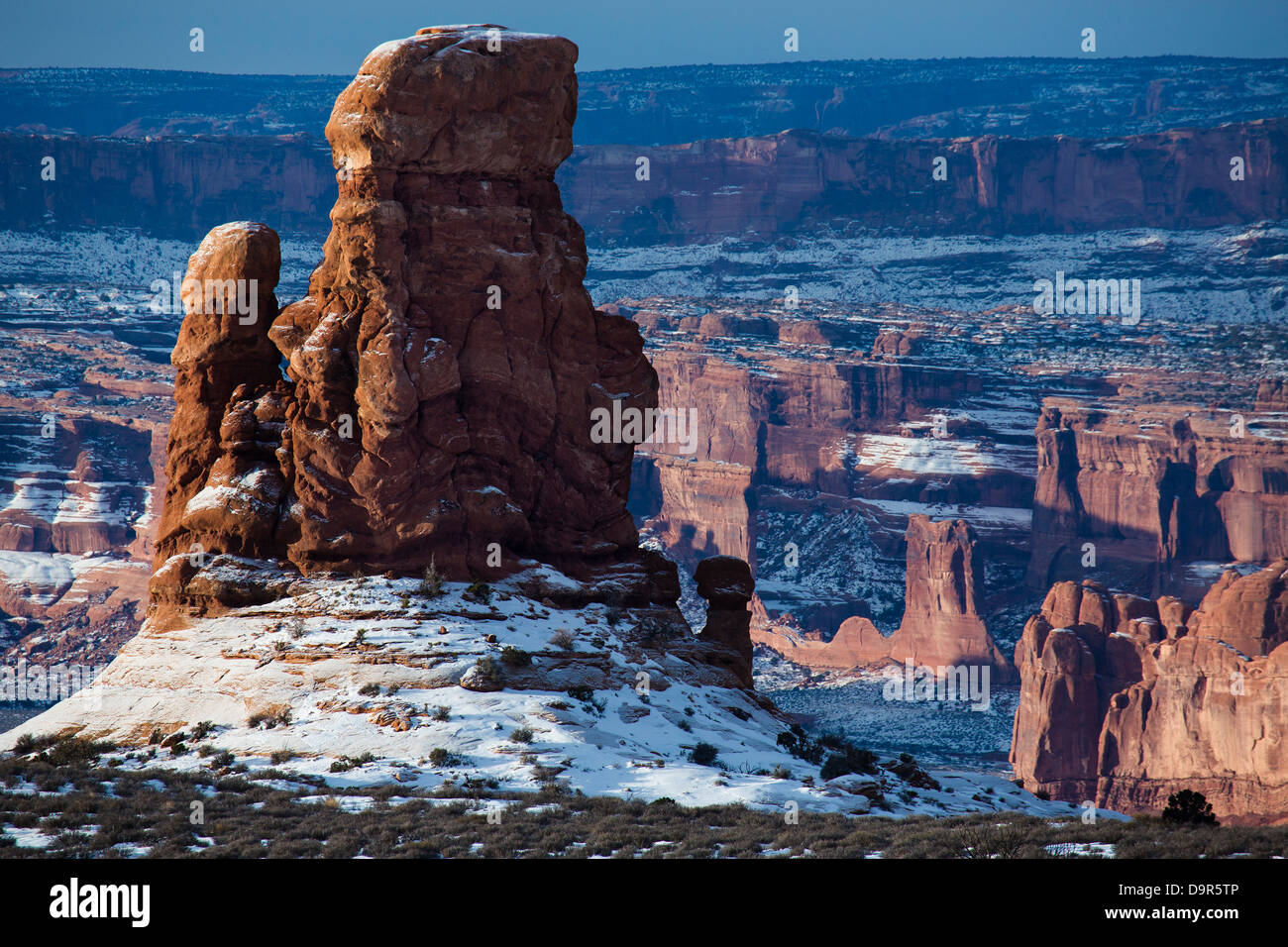 a rock stack in the region of the petrified sand dunes with the Courthouse Towers beyond, Arches National Park, - Stock Image
