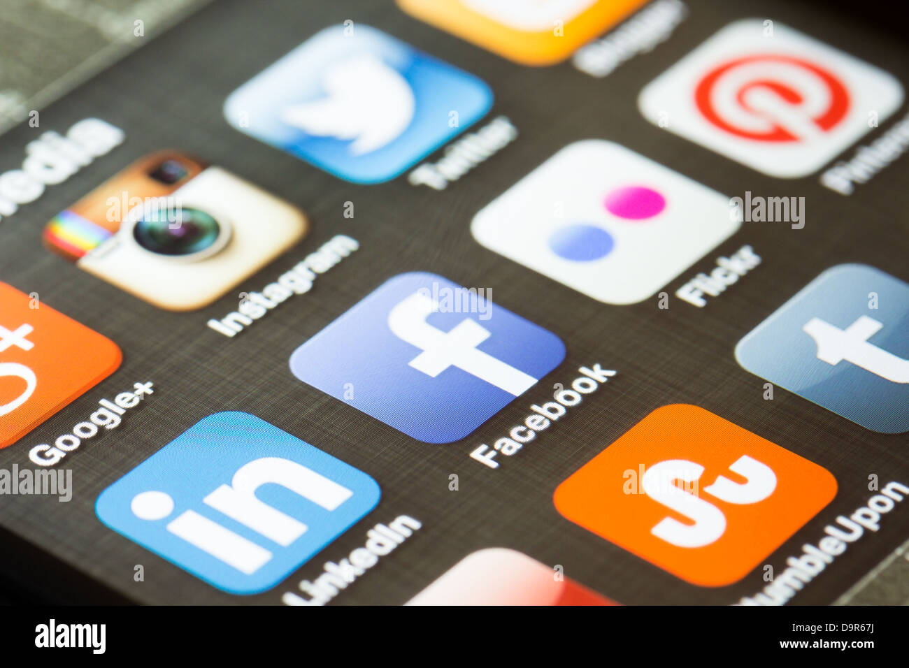 Social media app icons on an Apple iPhone 5 - Stock Image