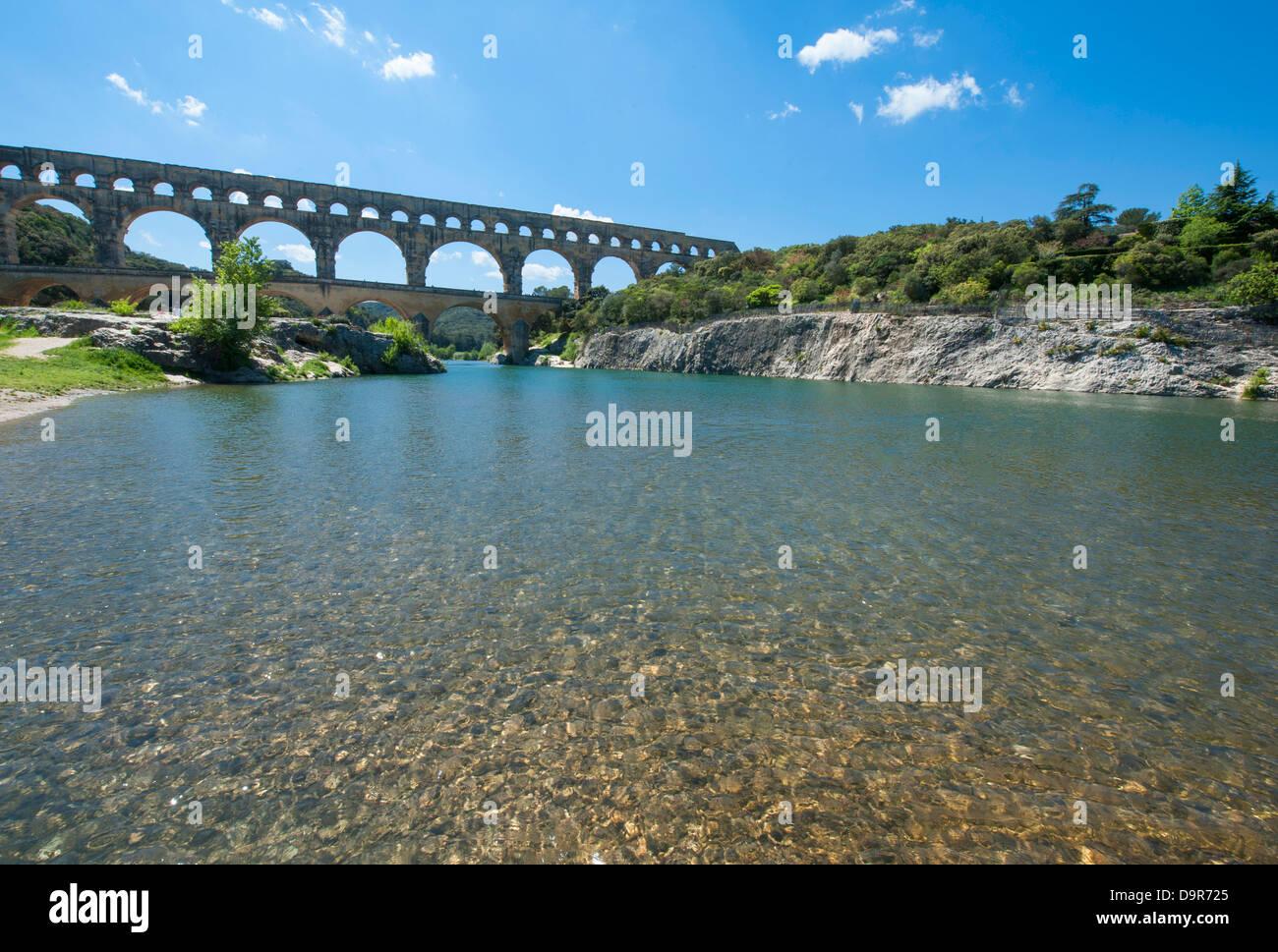 UNESCO world heritage Pont du Gard, a Roman aqueduct near Nîmes in the Gard, seen from the banks of the Gardon river. Stock Photo