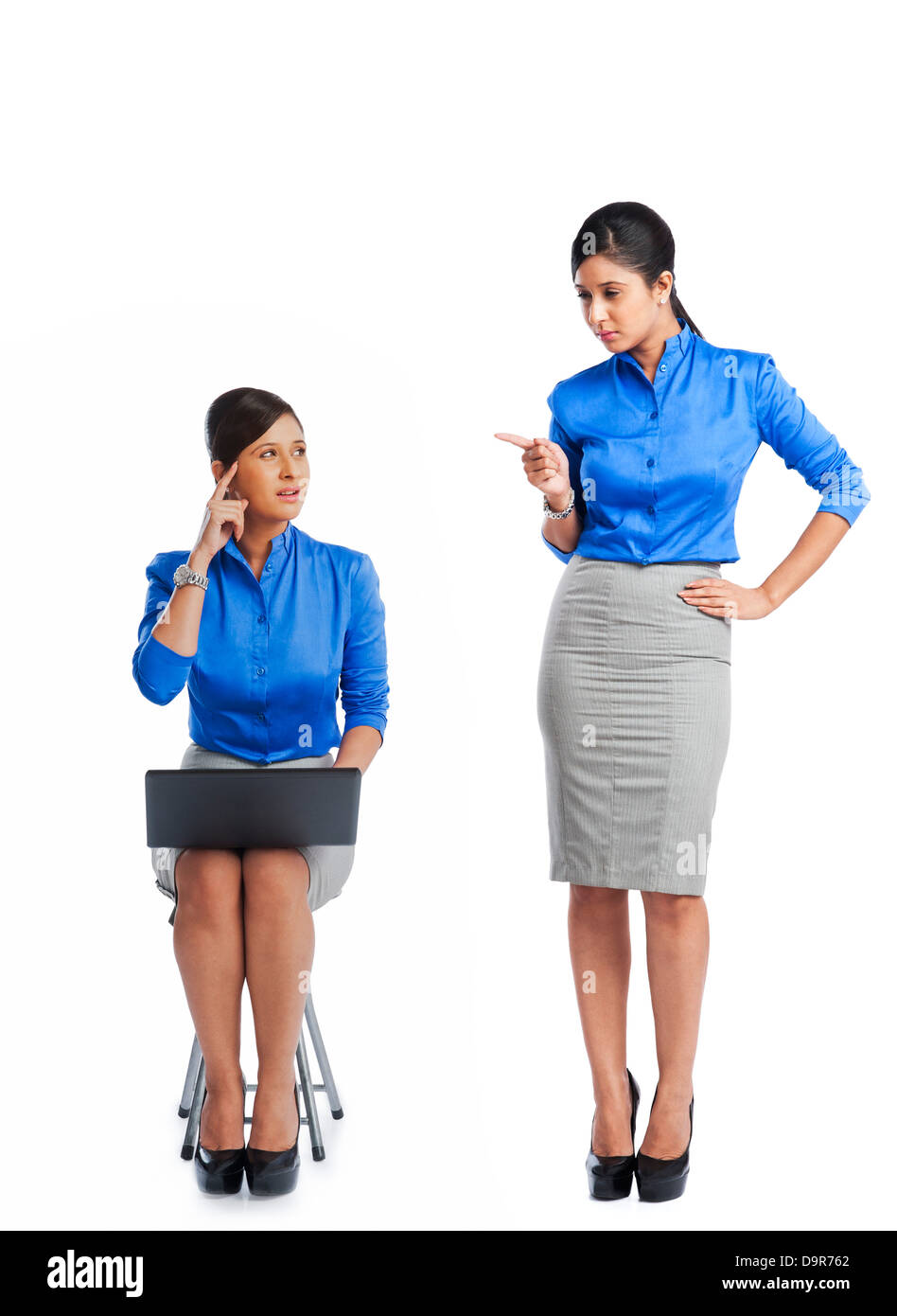 Businesswoman talking to her clone - Stock Image