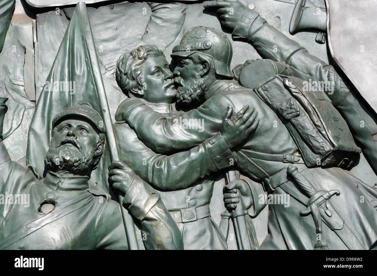 Part of the bronze relief by Moriz Schulz at the base of the Siegessaule or Victory Column, Tiergarten, Berlin, - Stock Image