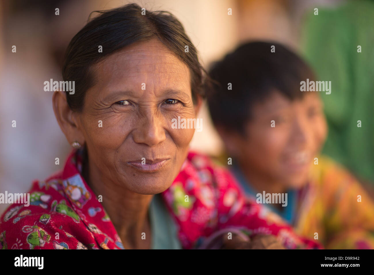 a woman at the Shwezigon Paya, Bagan, Myanmar (Burma) Stock Photo