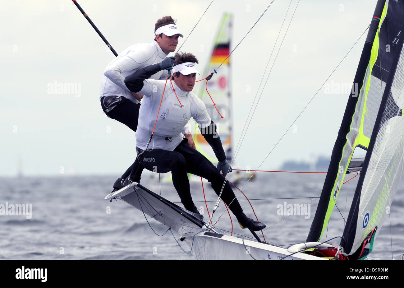 German yachtsmen Lennart Briesenick-Pudenz (L) and Hans Jakob Dethleffsen compete in a regatta of Olympic 49er dinghies - Stock Image